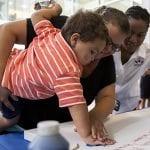 Eric Anderson, 2, places a handprint during the Hyundai Hope on Wheels Check Presentation and Handprint Ceremony at the Comer Children's Hospital on the University of Chicago campus in Chicago, Ill., on Thursday, September 4, 2014. (Photo by Andrew Nelles)