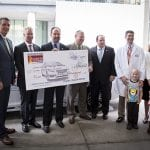 Guests pose with the check during the Hyundai Hope on Wheels Check Presentation and Handprint Ceremony at the Comer Children's Hospital on the University of Chicago campus in Chicago, Ill., on Thursday, September 4, 2014. (Photo by Andrew Nelles)