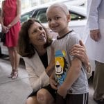 Dr. Susan Cohn greets Chris Ellis, 4, during the Hyundai Hope on Wheels Check Presentation and Handprint Ceremony at the Comer Children's Hospital on the University of Chicago campus in Chicago, Ill., on Thursday, September 4, 2014. (Photo by Andrew Nelles)