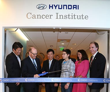 """From left, Mickey Pong, Chairman of the Board, Hyundai Hope on Wheels; Dr. Leonard Sender, Medical Director, Hyundai Cancer Institute; B.H. Lee, Chief Executive Coorinator Hyundai Motor America; CJ George, Hyundai Hope on Wheels Ambassador; Kim Cripe, President and CEO CHOC Children's and Jerry Flannery, Executive VP and General Counsel Hyundai Motor America cut the ribbon during """"Every Handprint Has A Story"""" Hyundai Hope on Wheels handprint ceremony at CHOC Children's Hospital on Tuesday, July 23, 2013, in Orange, Calif. (Photo by Ryan Miller/Capture Imaging)"""